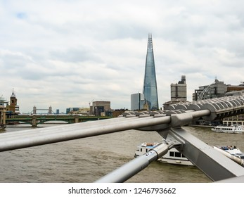 LONDON, UNITED KINGDOM - JUNE 10, 2013: London cityscape with Thames River Embankment and the Shard building. London, United Kingdom