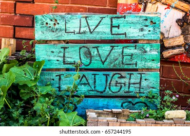 London, United Kingdom - June 10, 2017: Brixton Village and Brixton Station Road Market. Colorful and multicultural community market run by local traders in South London. Live Love Laugh painted box