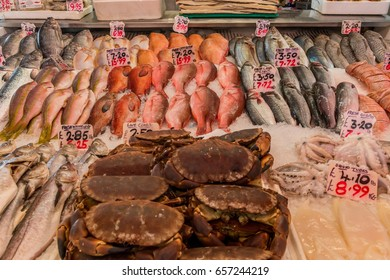London, United Kingdom - June 10, 2017: Brixton Village and Brixton Station Road Market. Colorful and multicultural community market run by local traders in South London. Fish stall