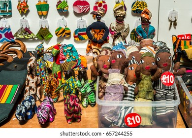London, United Kingdom - June 10, 2017: Brixton Village and Brixton Station Road Market. Colorful and multicultural community market run by local traders in South London. African dolls