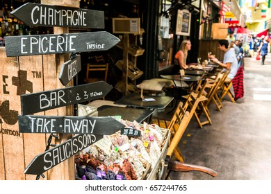 London, United Kingdom - June 10, 2017: Brixton Village and Brixton Station Road Market. Champagne shop and people in cafes
