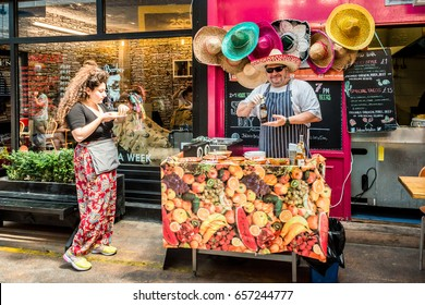 London, United Kingdom - June 10, 2017: Brixton Village and Brixton Station Road Market. Tacos restaurant stall and mexican hats