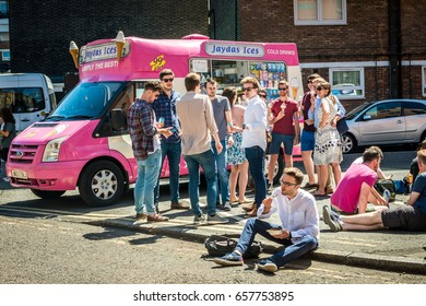 London, United Kingdom - June 10, 2017: Maltby Street Market in Bermondsey. Great artisan street food stalls and bars. Ice cream van and people sitting outside