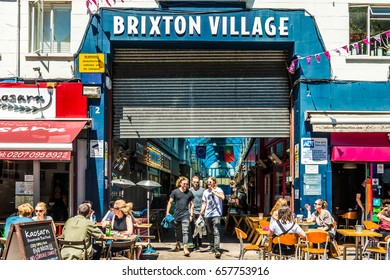 London, United Kingdom - June 10, 2017: Brixton Market - Colorful and multicultural community market run by local traders in South London. Brixton Village sign
