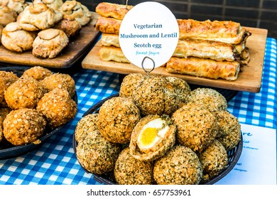 London, United Kingdom - June 10, 2017: Maltby Street Market in Bermondsey. Great artisan street food stalls and bars. Vegetarian Scotch egg