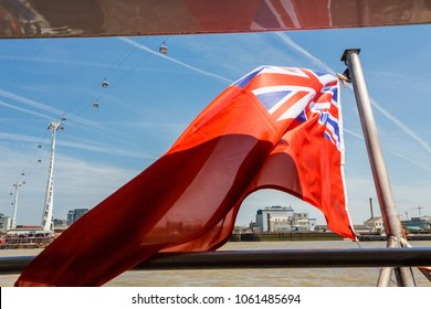 London, United Kingdom - June 11, 2015: Used by merchant ships the Red Ensign or Red Duster is a civil ensign. Shown here on a ferry boat on the River Thames in London.