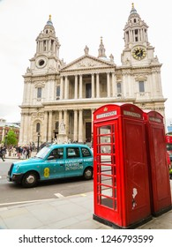 LONDON, UNITED KINGDOM - JUNE 11, 2013: Symbols of London in front of the St. Paul's Cathedral. Red phone booth and the London taxi near the Western portico of St. Paul's Cathedral. London, UK