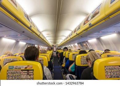 London, United Kingdom - June 11, 2019: Inside Ryanair airplane during a flight. Ryanair is the biggest low-cost airline company in the world