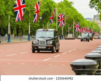 LONDON, UNITED KINGDOM - JUNE 12, 2013: Classic London black cab on street of London city. London, UK