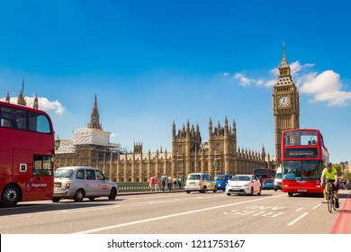 LONDON, UNITED KINGDOM - JUNE 14, 2016: Big Ben, Westminster Bridge and red double decker bus in London, England, United Kingdom on June 14, 2016