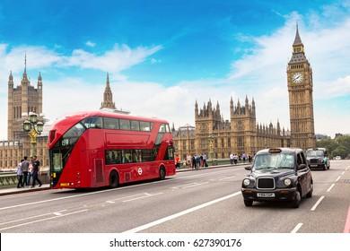 LONDON, UNITED KINGDOM - JUNE 14, 2016: Big Ben, Westminster Bridge and red double decker bus in London, England, United Kingdom on June 14, 2016