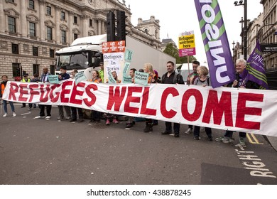London, United Kingdom - June 18, 2016: Refugees Welcome. A fleet of vehicles met in Whitehall this morning to start a convoy to Calais, in particular The Jungle, to give aid to the refugees.