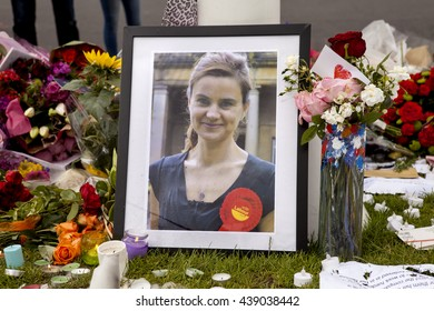 London, United Kingdom - June 18, 2016: Jo Cox. An impromptu memorial site in Parliament Square, to Jo Cox the murdered MP, remains a place for people in London to come to, to mourn her loss.