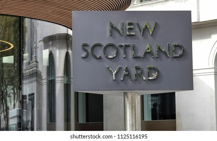 London, United Kingdom, June 2018. The Scotland yard, characterized by the brilliant rotating sign. On the opposite bank of the Thames the london eye.