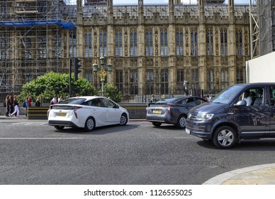 London, United Kingdom, June 2018. In this city the use of Toyota hybrid cars with electric petrol engines is widespread, the prius model in particular. Here two prius fourth series as they turn.