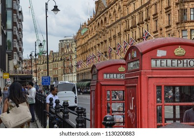 London, United Kingdom, June 2018. Street view of London's Harrods department store, the beauty of the building and the flags of the United Kingdom do not go unnoticed. A luxury mall attracts crowds .
