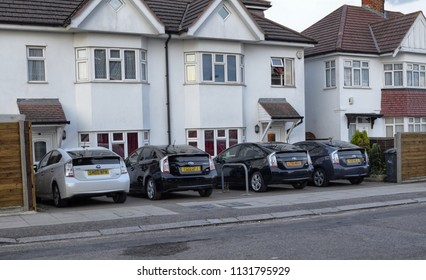 London, United Kingdom, June 2018. In this city the use of Toyota hybrid cars with electric petrol engines is widespread, in particular the prius model. Here five prius third series, in the suburbs.