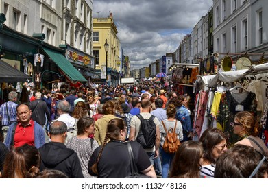 London, United Kingdom, June 2018. In the famous Nottin Hill district the Portobello Road market: along the way, starting from its beginning, vintage shops stalls and later foods attract people.