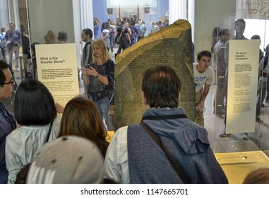 London, United Kingdom, June 2018. At the British Museum, the Rosetta Stone. It is made of granodiorite. It was a decisive key for understanding hieroglyphs. Visitors flock to see it