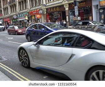 London, United Kingdom, June 2018. In this city the use of Toyota hybrid cars with electric petrol engines is widespread, in particular the prius model. A beautiful tourist looks out the window.