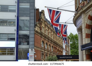 London, United Kingdom, June 2018. At Leicester Square, we can find one of the symbols of the city on display: the flag of the United Kingdom.