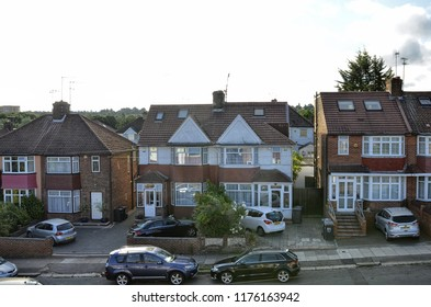 London, United Kingdom, June 2018. The typical London houses of red brick and white finishes, small courtyard on the entrance, private garden at the back. London suburbs, colindale.