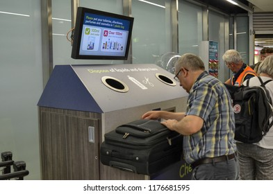 London, United Kingdom, June 2018. Gatwick gatwick airport, checkpoint for carry-on baggage. There are special containers where to throw licquids and sharp objects that would not pass the check.