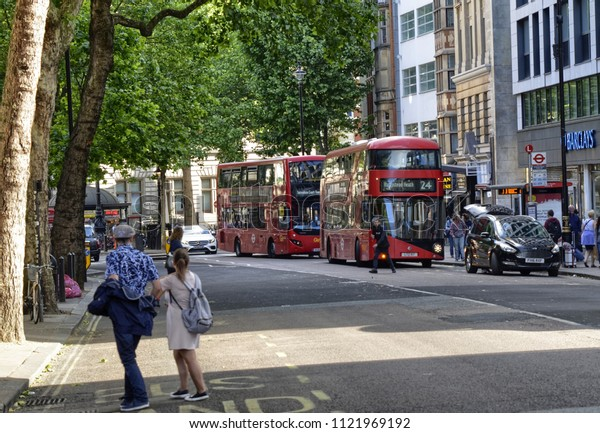 London, United Kingdom, June 2018. The appearance of the city around the Leicester square metro station. Double-decker buses, taxis called cabs, crowds of tourists.