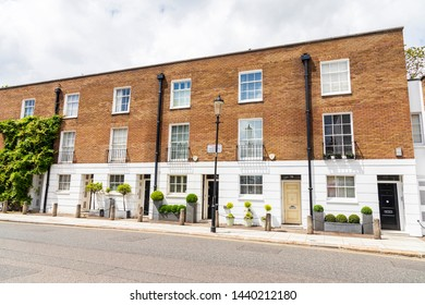 LONDON, UNITED KINGDOM - JUNE 2019: Street of 19th century Victorian terraced houses, without cars in Chelsea, London, UK