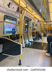 London / United Kingdom — June 21, 2018: the interior of the modern S-stock underground train of the Circle Line of London Tube, the oldest subway system of the world