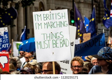 LONDON, UNITED KINGDOM - JUNE 23, 2018: Anti-Brexit protest in London with man carrying banner saying 'I'm British. I'm marching. Things must be bad'.