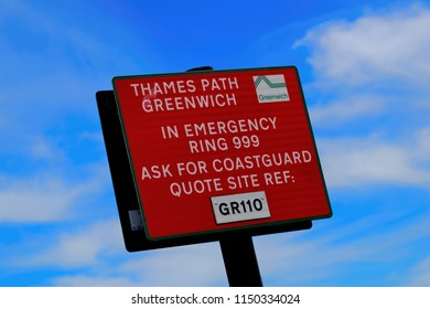 London, United Kingdom - June 23, 2018: Sign by River Thames, London, United Kingdom, providing emergency contact details for the coastguard and location details