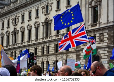 London / United Kingdom — June 23, 2018: the United Kingdom and European Union flags held by the demonstrators who oppose Brexit at the pro-EU meeting near the Houses of Parliament in London