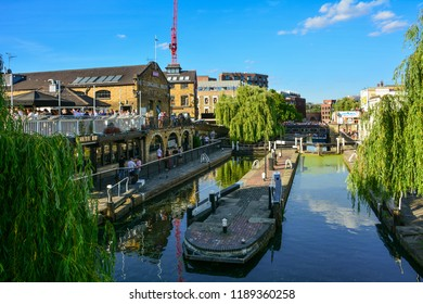 London / United Kingdom — June 24, 2018: the Camden Lock on the Regent's Canal, also known as Hampstead Road Lock. The lock is located in the Camden Town district near the famous market