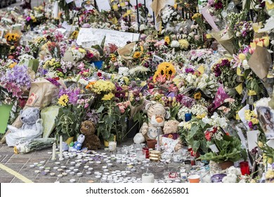 London, United Kingdom - June 24, 2017: Flowers left by a church near Grenfell Tower in west London which went on fire on the 14th of July and left dozens dead.