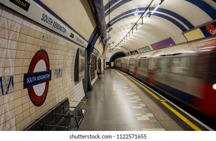 London / United Kingdom - June 25, 2018: Piccadilly Line train of London Tube arriving at South Kensington station