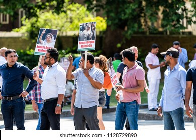 London, United Kingdom - June 25, 2018: People, men closeup at Bangladesh protest in UK England by Westminster with signs for Begum Khaleda Zia, former Nationalist Party leader