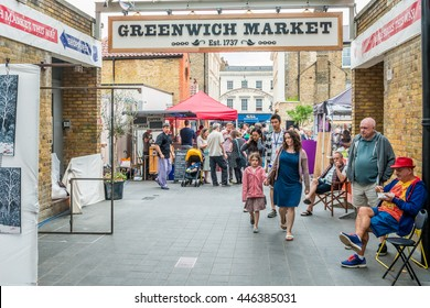 London, United Kingdom - June 25, 2016: Greenwich market. Entrance sign, art traders, and people walking