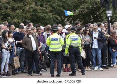 LONDON, UNITED KINGDOM - JUNE 25, 2017 : Metropolitan police and tourist waiting for ceremonial changing of the London guards in front of Buckingham Palace. This is one of  major attractions in London