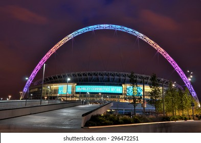 London, United Kingdom - June 26, 2015 : Brightly colored lit Wembley Stadium at dusk. Wembley Stadium is a football stadium in Wembley Park, London, England, which opened in 2007.
