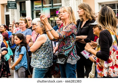 London, United Kingdom - June 26, 2017: Greenwich and Docklands International Festival. OSADIA hairdressing and theatre performance. Spectators are taking photos