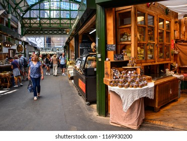 London / United Kingdom — June 27, 2018: a scene at one of the shops of Borough Market in Southwark, London. The Borough Market is a famous food market. Its stalls and shops are popular among tourists