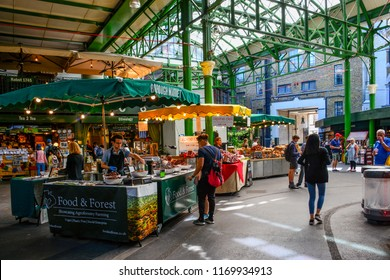 London / United Kingdom — June 27, 2018: stalls at the Borough Market in Southwark, London. The Borough Market is a famous retail food market. Its stalls and shops are popular among tourists