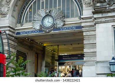 London / United Kingdom - June 28 2019: Close up of the Victory Arch and the pedestrian entrance to Waterloo Train Station. Rush hour with people passing