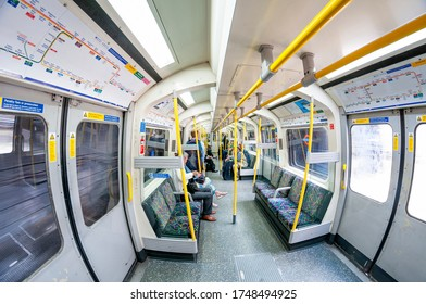 London/ United Kingdom - June 4 2013: Passengers on a train in the London Underground