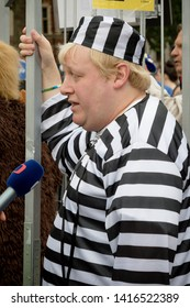 London, United Kingdom, June 4th 2019:- A Boris Johnson lookalike in Prison Uniform in Parliament Square protesting against the up coming court case the leading candiate to replace the Prime Minister