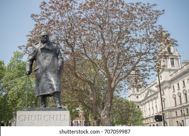 London, United Kingdom - June 5th, 2016: Statue of Winston Churchill standing in Parliament Square opposite the Palace of Westminster, the seat of the British Parliament.