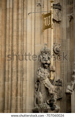London, United Kingdom - June 5th, 2016: Statue of a lion on the Palace of Westminster at the Sovereign's entrance, under the Victoria Tower.