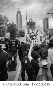 London, United Kingdom - June 7 2020: Black and white photo of a man in a Colin Kaepernick jersey at a black lives matter protest in front of the US Embassy in London