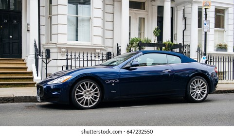 LONDON, UNITED KINGDOM - MAR 11, 2017: Luxury Maseratti GranCabrio blue exclusive cabrio car parked in front typical townhouse city house in London nighwborhood